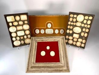 Group of Grand Tour plaster intaglios, consisting of two antique wood trays fitted with numbered intaglios, plus framed groupings of three and (later) six intaglios (est.  $500-$800).