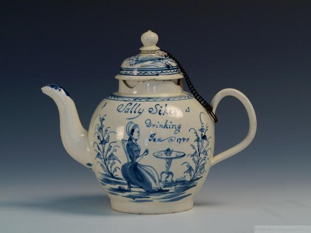 "An illustrated Staffordshire creamware teapot with ""Sally Sikes Drinking Tea, 1780"" inscription"