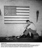 Jasper Johns with flag by Robert Rauschenberg