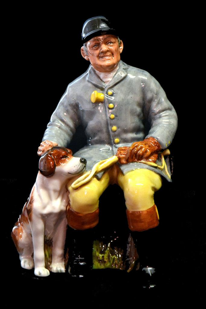 This Royal Doulton figurine titled The Hunstman is one of many horse-themed items in the auction, as well as being highly collectible.