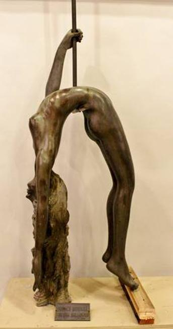 This bronze sculpture of a female trapeze artist by Victor Salmones will be sold Oct.  6.