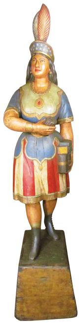 This antique Cigar Store Indian figure, by the renowned 19th century maker Samuel Robb, cast iron, later repainted, 82 inches tall, will be sold at auction Oct.  2-4.