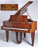 Maurice Dufrène designed Piano, 1925, Gaveau company, amboyna and sculpted purple heart, Calderwood Gallery