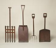 "Shaving shovel, wood, metal, 52 ⅜"" x 14 ⅝"" x 3 ⅓"", 1950.3485.  Snow Shovel, pine, maple, iron, 56 ½"" x 15 ⅜"" x 5 ⅛"" 1950.3355.1 Spading Fork, wood, metal, 42 ¾"" x 8 ⅞"" x 3 ⅜"", 1950.3201.1 Shovel, Oak, iron, 42 ⅜"" x 16 ⅝"" x 1 ⅞"", 1952.4656.1 Collection of the Shaker Museum