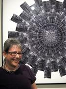 "Adrienne Moumin in front of ""Kaleidoscope (Starrett-Lehigh)."" Photo by Joseph Silva."