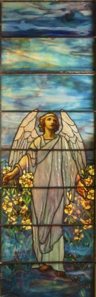 This turn-of-the-century Tiffany Studios memorial stained glass window sold for $71,300 at Cottone Auctions.