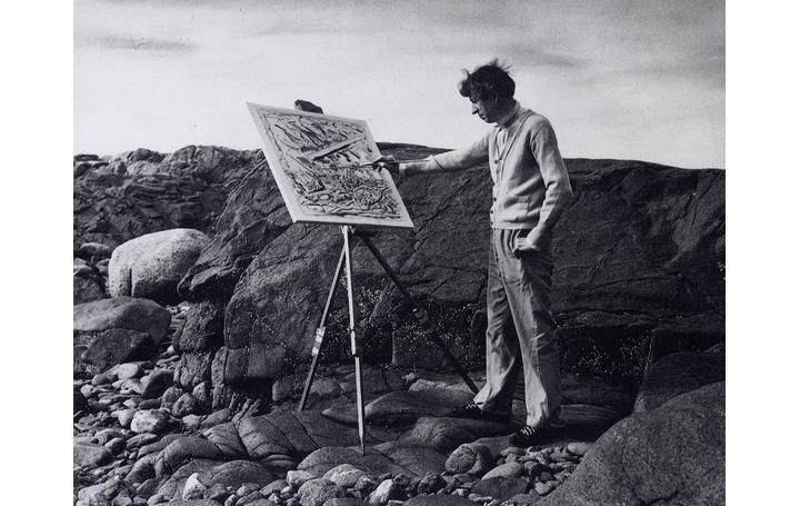 John Marin painting on the rocks at Cape Split in Addison, Maine.  Photographer unknown.  Used by permission of the estate of John Marin.