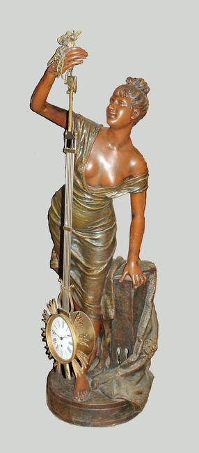 "This signed, life-size bronze figure with upside-down clock movement (also known as a ""swinger"" clock) will be sold May 27-29."