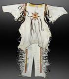 This early 1900s hand-crafted white buckskin Mandan war shirt with matching leggings should realize $4,000-$8,000.