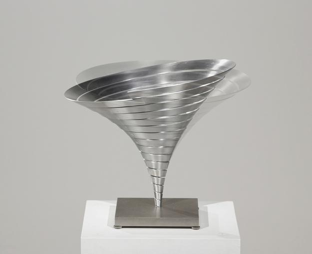 Martin Willing (b.  1958) Parabolkegel groß, 1991 Duraluminum, water jet cut, curved, prestressed, embedded in titanium plate 11 3/8 (H) inches, 14 1/8 inches diameter (29 (H) cm, 36 cm diameter)