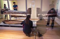 The mummy and coffin of ancient Egyptian priest Nesmin (250 BCE) are moved into a new, state-of-the-art, climate-controlled case in the RISD Museum's newly renovated galleries for ancient Egyptian art.  Tiered mountings and LED lights allow visitors to more effectively view the mummy, the coffin's exterior, and beautiful but previously hidden interior paintings.