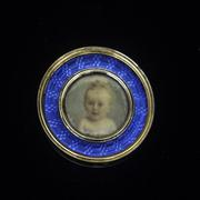 Miniature portrait in a medallion showing the infant Prince Sergei Sergeevich, 1898.  Watercolor on ivory, 14K yellow gold, blue guilloche enamel, ivory back, 1 1/2 x 1/4 inches (framed).  Promised gift of Marina Belosselsky-Belozersky Kasarda