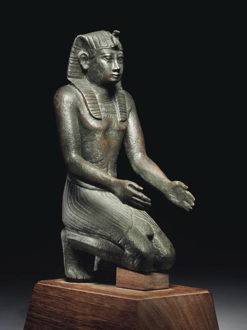 PROPERTY FROM THE CATTAUI FAMILY COLLECTION AN EGYPTIAN BRONZE FIGURE OF PHARAOH NECHO II LATE PERIOD, 26th DYNASTY, REIGN OF NECHO II, CIRCA 610-595 B.C.  Estimate: $150,000-250,000