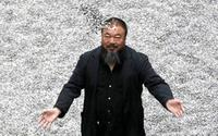 "Ai Weiwei at his exhibition ""Sunflower Seeds,"" a work consisting of 100 million hand-painted porcelain seeds, currently installed at the Tate Modern in London."