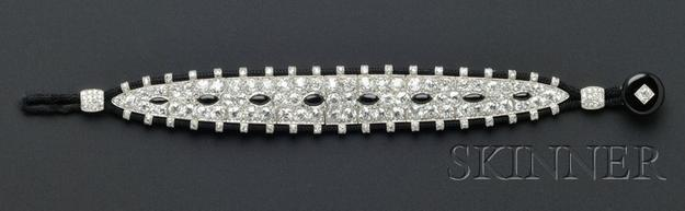 An Art Deco Cartier black, onyx and diamond bracelet sold for $253,000, against an estimate of $30,000 to $40,000.  The piece came from the collection of Mrs.  Hope Goddard Iselin of New York and Newport, the first woman to compete in the America's Cup.