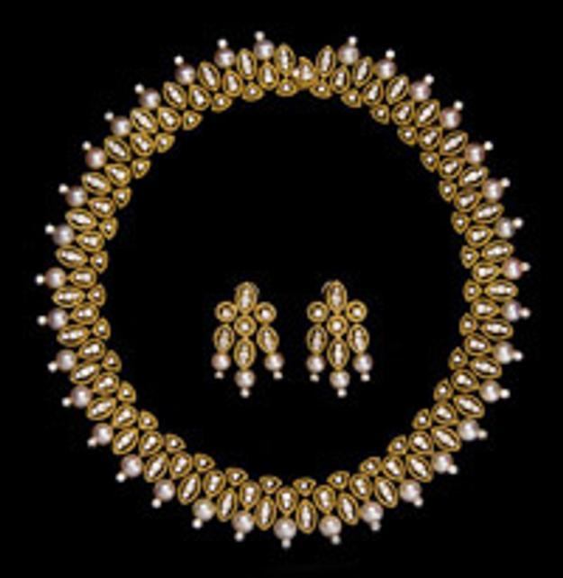 A Hammerman Brothers 18 karat yellow gold necklace and earrings, contains 285 round brilliant cut diamonds and 40 cultured pearls (estimate $15,000 to $20,000).