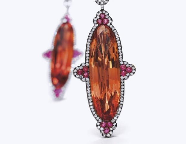 A Pair of Imperial Topaz, Ruby and Diamond Ear Pendants, by JAR.  Estimate: $300,000-$500,000.