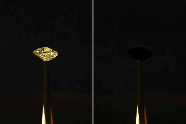 The MIT team cloaked a 16.78-carat natural yellow diamond in their material to show how it disappeared into darkness.