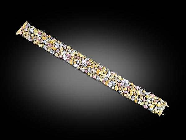 Another masterpiece from M.S.  Rau's extensive Jewelry Collection: A veritable rainbow of colored diamonds are showcased in this exquisite bracelet