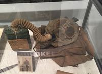 Private Spinetto's gas mask and photograph from World War I.