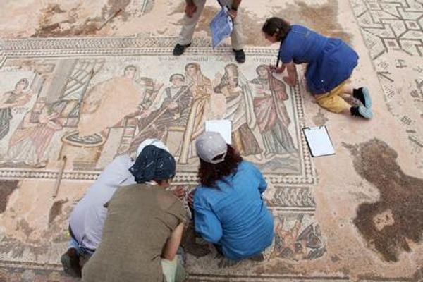Participants in a Getty-funded course on conservation and archaeological site management conduct a condition survey exercise of the Achilles Mosaic at the Paphos Archeological Park in Cyprus.  Photo: J.  Paul Getty Trust.