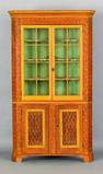 Penn.  two-part corner cupboard, 19th c., at Pook and Pook.