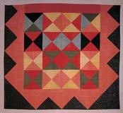 "HARLEQUIN MEDALLION QUILT, Artist unidentified, New England, 1800-1820.  Glazed wool 87 x 96"".  American Folk Art Museum, New York, gift of Cyril Irwin Nelson in loving memory of his grandparents John Williams and Sophie Anna Macy, 1984.33.1."