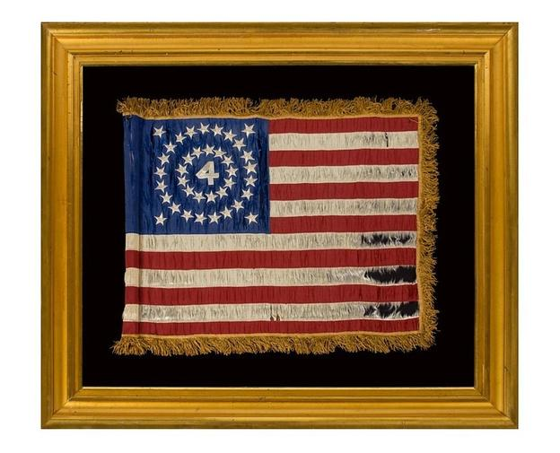"A rare and beautiful 38-star flag, An Indian Wars period flank guidon of the 4th U.S.  Infantry, with a medallion configuration surrounding the numeral ""4"" (1876-1889), Colorado Statehood."