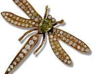 Jerome Heidenreich, based in Los Angeles, will display this beautiful dragonfly brooch set with a GIA certified 1.81 carat natural fancy intense green-yellow diamond, circa 1960.