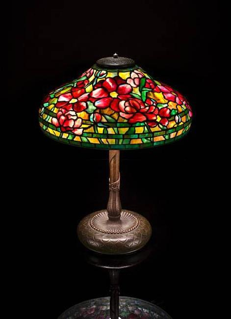 A fine Tiffany Studios Favrile glass and bronze Peony lamp, 1899-1918, estimate: $125,000 - 160,000