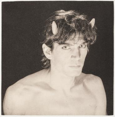 "From the 20th century printing of Rimbaud's ""A Season in Hell"", with photographs by Robert Mapplethorpe.  Bi-lingual translation by Paul Schmidt."