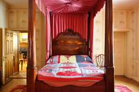 Log Cabin Quilt, 1990, by Polly Raymond of Gee's Bend, AL, graces the Parlor Bedroom's mahogany four-poster bed as part of the Community Threads quilting exhibition at Hill-Stead Museum, on view through March 28, 2010.  Photo by Ben Jordan.