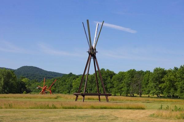 View of the south fields, all works by Mark di Suvero.  Left to right: Figolu, 2005–11.  Courtesy the artist and Spacetime C.C.  E=MC2 , 1996-97.  Courtesy the artist and Spacetime C.C.  ©Mark di Suvero, courtesy the artist and Spacetime C.C., New York.  Photo courtesy Storm King Art Center.