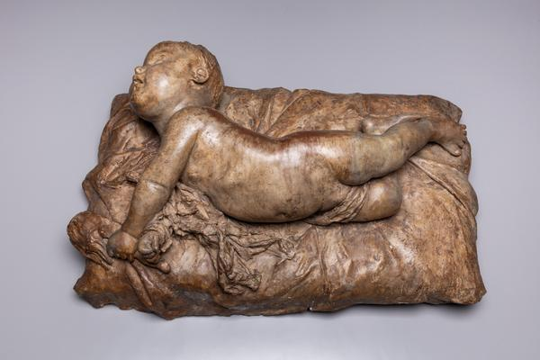 Agustín Querol y Subirats (Spanish, 1864–1909), A Baby Rolling Over, 1884–87.  Terracotta, 15 ¾ x 25 ¼ x 8 ¾ in.  (40 x 64 x 22 cm).  Meadows Museum, SMU, Dallas.  Given by Michael P.  Mezzatestain honor of William B.  Jordan, MM.2020.02.  Photo by Kevin Todora.