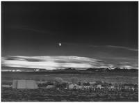 Moonrise, Hernandez, New Mexico shows a nighttime moon over a cloud-fringed mountain range with a graveyard in the foreground. (Ansel Adams, Ansel Adams Publishing Rights Trust / September 17, 2007)