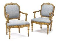 A superb set of four late 18th century Italian Neoclassical giltwood armchairs (2 shown) each with an octagonal back carved with a laurel band over outset arms carved as ribbon tied clustered vines above water reed carved supports on tapering fluted legs, upholstered in Fortuny fabric.  (est.  $35/50,000).  Friia.  When the residence was later updated by Albert Hadley and Gary Hager of Parish-Hadley Associates, the chairs were reupholstered.  They are illustrated in Architectural Digest, May, 19