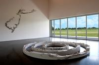 Installation view of the exhibition, Platform: Maya Lin.  Parrish Art Museum, Water Mill, New York.  July 4-October 13, 2014.  In foreground, Equator (2014), Latitude New York City (2013) and Arctic Circle (2013).  On wall, Pin River—Sandy (2013).