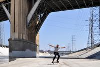 """Los Angeles River, Arts District Resident """"Chad"""" Skating in the River Channel under the 6th Street Bridge ©2014 Barron Bixler"""