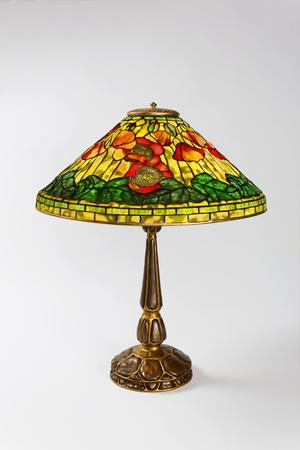"Macklowe Gallery- A Tiffany Studios New York wire mesh ""Poppy"" leaded glass and gilt bronze table lamp."