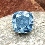 This fancy vivid blue modified rectangular brilliant-cut diamond weighing 7.03 carats sold at Sotheby's Geneva for 10,498,500 CHF