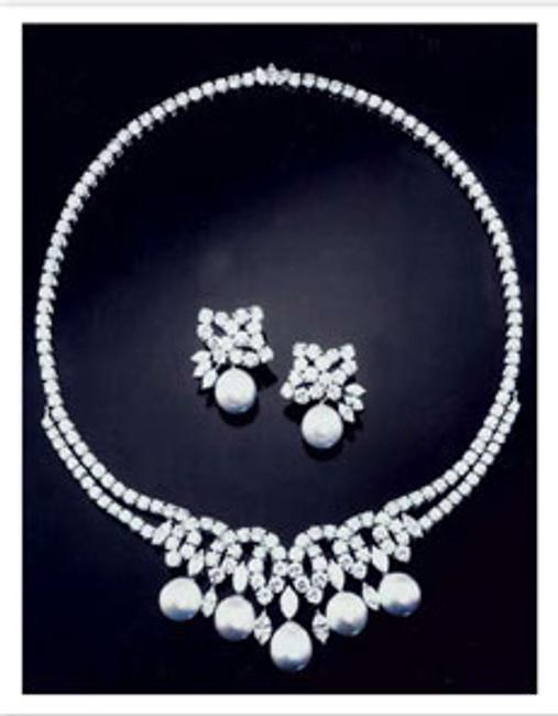 The stunning diamond and pearl necklace and earrings, designed with input from Princess Diana, made by the distinguished English firm, Garrard, the Crown Jewelers.
