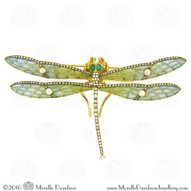18k yellow gold pliquea jour diamond and emerald dragonfly brooch.  Represented by MorelleDavidson, Booth 2306.