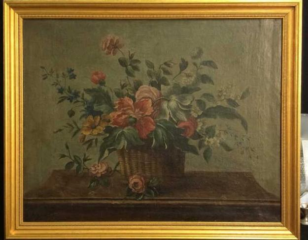 This floral still life on canvas painting, Italian School, circa 1800, depicting tulips, roses and chrysanthemums in a basket, was bought at Sotheby's in December 1997 from the estate of the late conductor and composer Leonard Bernstein.