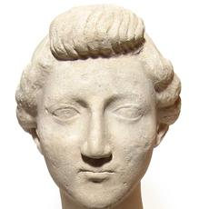 Lovely Roman marble head of a woman from the Julio-Claudian Period (circa early 1st Century BC), in the manner of the Empress Livia Drusilla (aka Julia Augusta).  (est.  $9,000-$12,000).