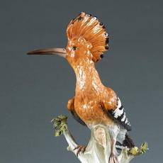 "19th-century Meissen porcelain Hoopoe Bird, after 18th-century model of J.J.  Kaendler.  Unglazed base with faint blue crossed swords and incised with model numbers 278 and 78.  Bottom has original ""Bing Jr & Co Frankfurt"" retailer paper tag.  Approximately 12 5/8 by 5½ by 8 inches.  Provenance: Estate of Catherine Spencer Eddy Beveridge and her aunt, Delia Macomb Spencer Field, the second wife of Marshall Field.  Estimate $600-$900"