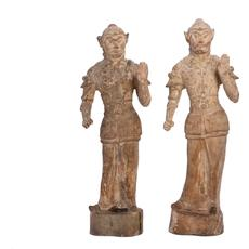Two Chinese pottery models of warriors from the Tang dynasty, each one 34 inches tall (est.  $4,000-$6,000).