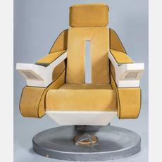 Reproduction Starfleet Command Captain Picard's chair, made by Cedar Fair Entertainment Company, 20th century, electrified with lighting, 48 ½ inches tall (est.  $80-$120).