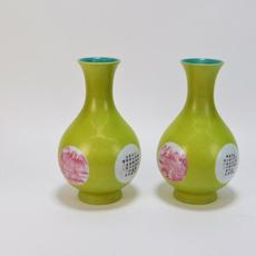 Pair of Chinese Qing Dynasty chartreuse raspberry porcelain vases, both 9 inches tall and each one decorated with two calligraphy cartouches and two landscape panels (est.  $1,000-$2,000).