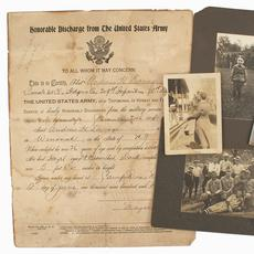 "Archive of material pertaining to American World War I ""doughboy"" PFC Andrew Savage, who served in the 309th Infantry, 78th division, to include various medals, patches, photos and helmet."