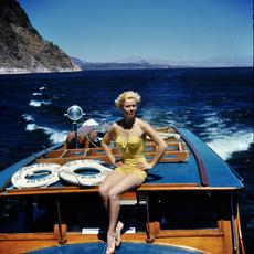 Doris Day in her swimsuit on a boat ride in Spain in the early 1950s.